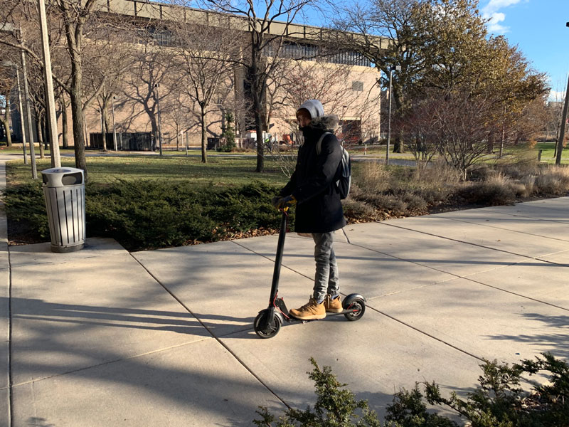 UIC student riding scooter photo
