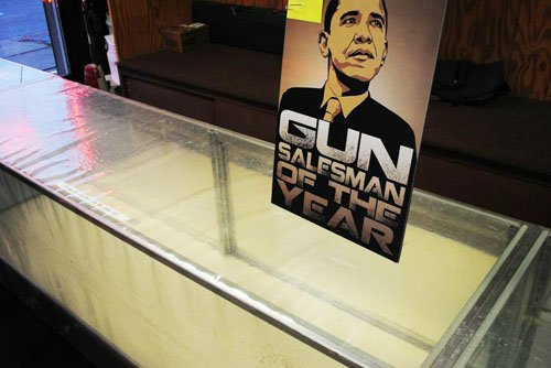One of the empty cases that line Illinois Gun Works. The poster of Barack Obama is being sold for $6.